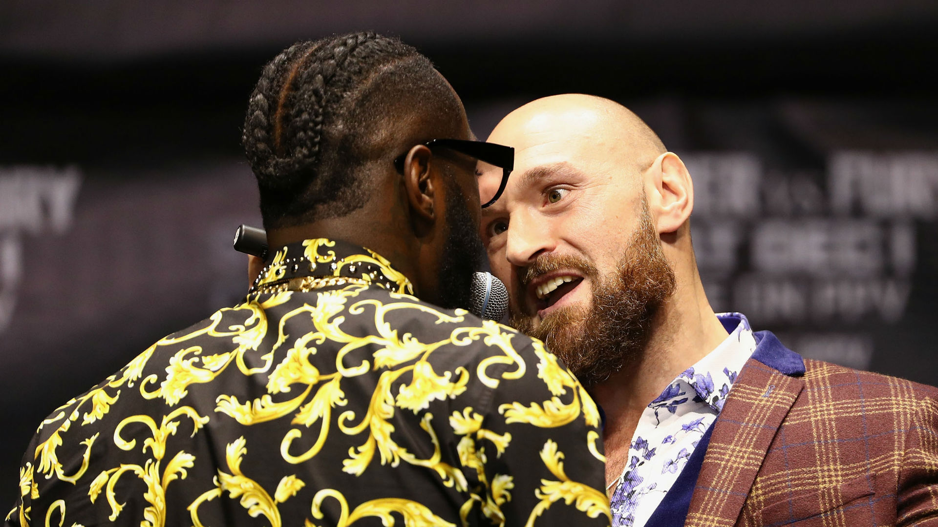 A scuffle broke out after Deontay Wilder had poked Tyson Fury in the face in their final news conference before their heavyweight bout.