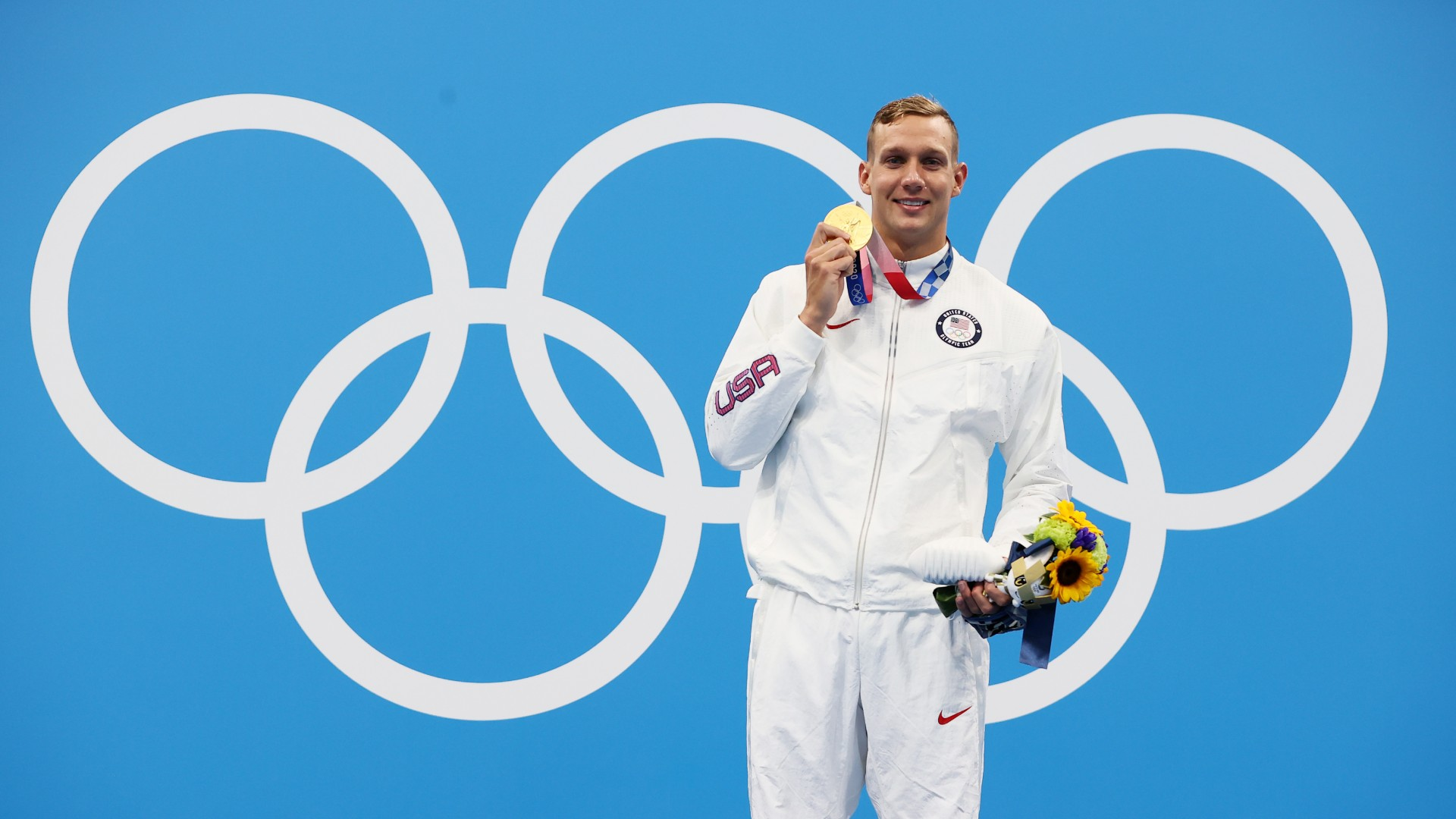 Caeleb Dressel edged rival Kyle Chambers for the 100m freestyle title, his first individual Olympic gold.