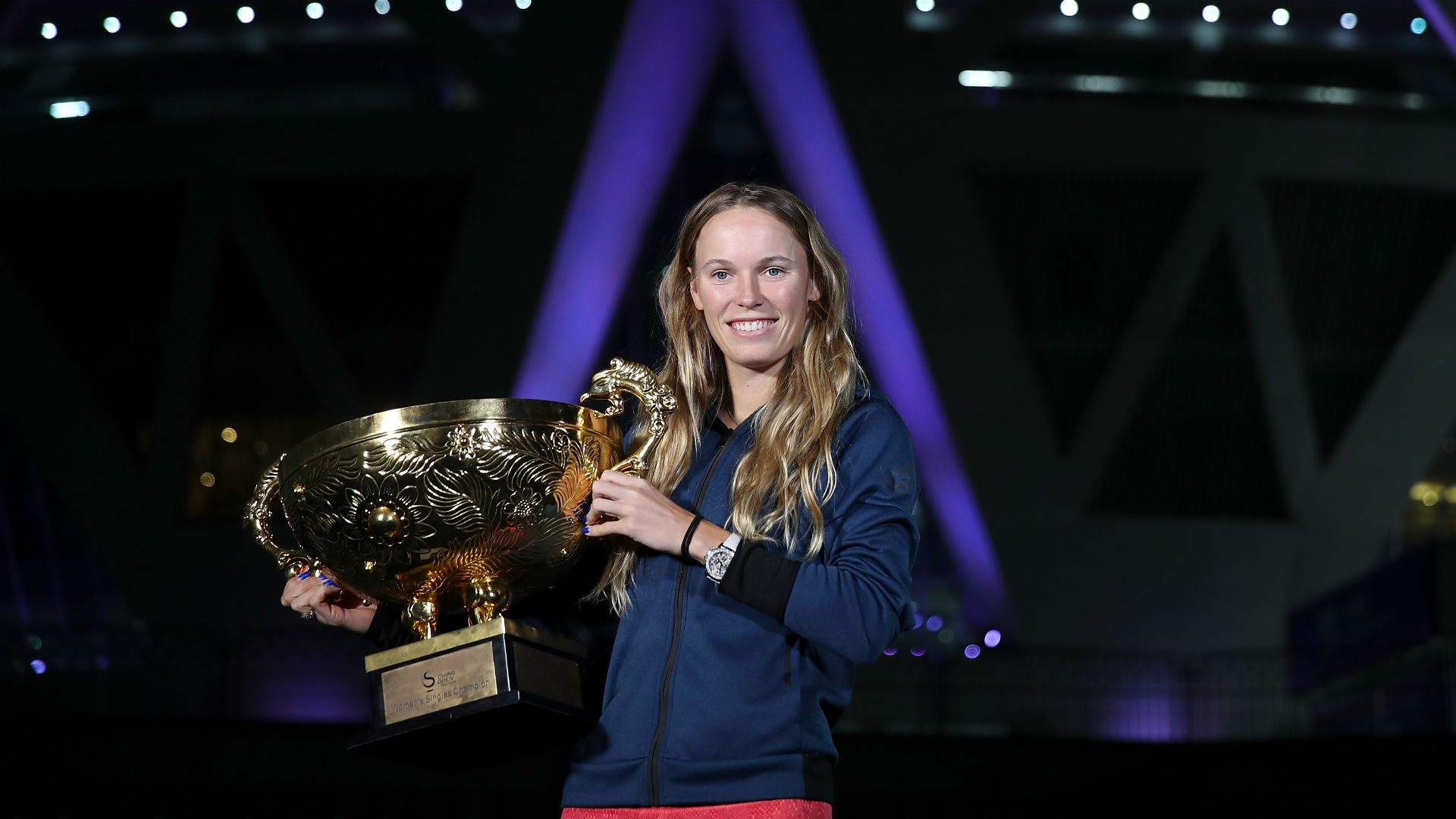 Eight years after winning her first WTA Tour title at the China Open, Caroline Wozniacki got her hands back on the trophy.