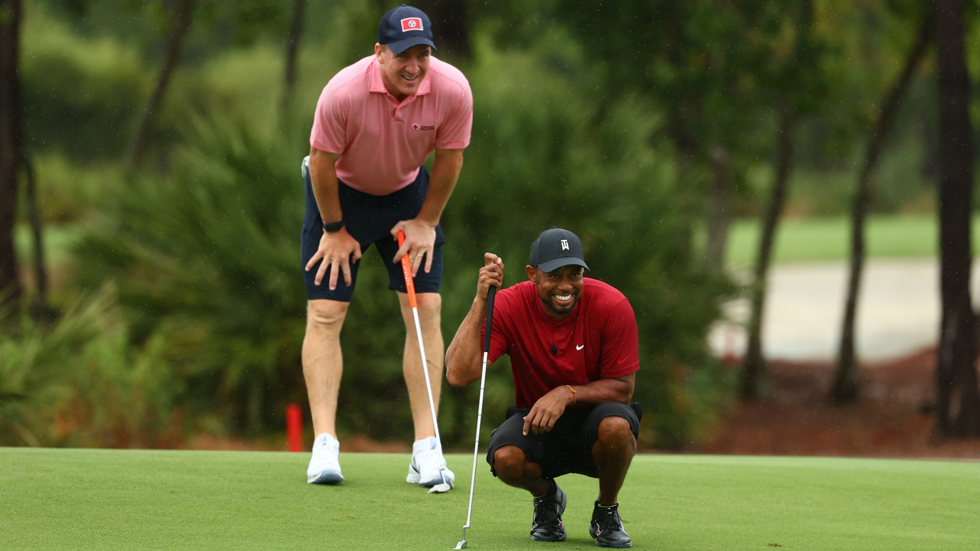 Tiger Woods and Peyton Manning won, all in the name of charity on Sunday.