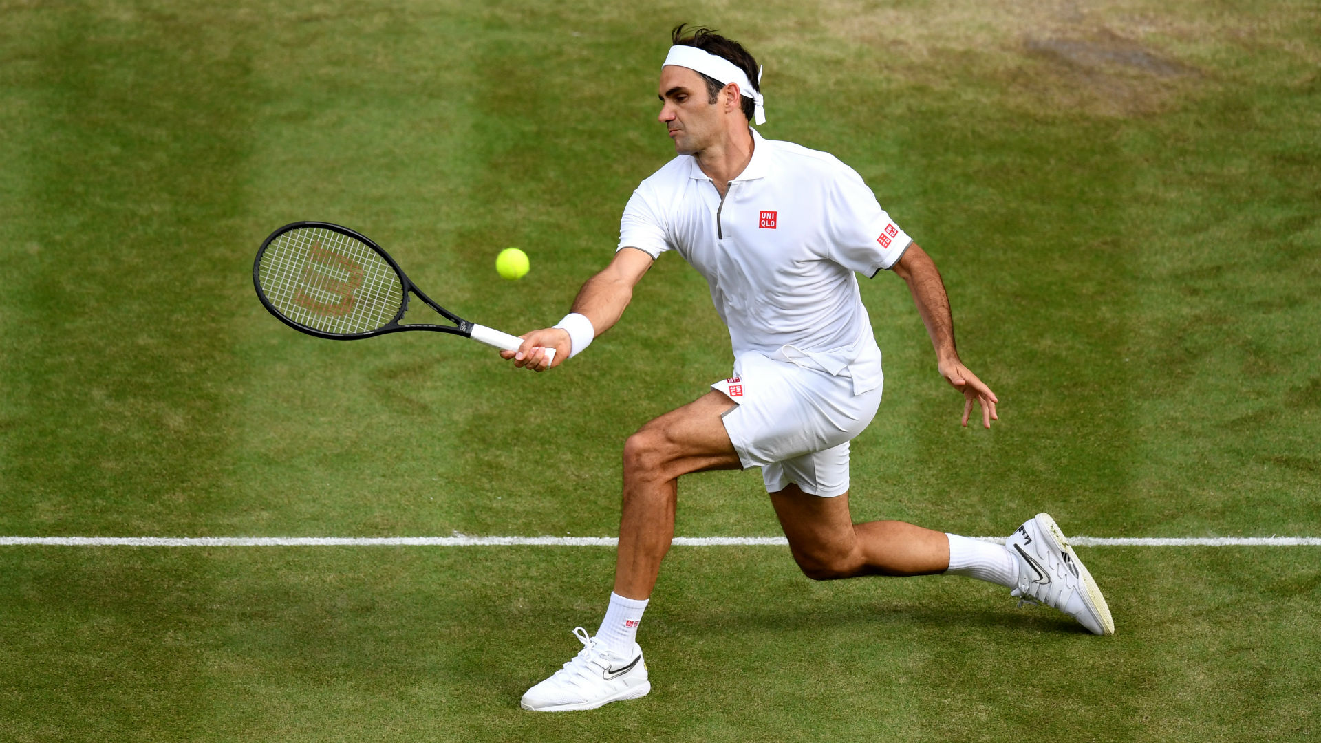 Federer claims historic 100th win