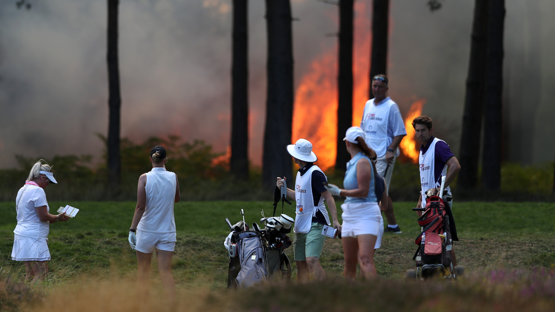 A fire that started on Chobham Common made it too dangerous for Friday's play at the Rose Ladies Series Grand Final to continue.