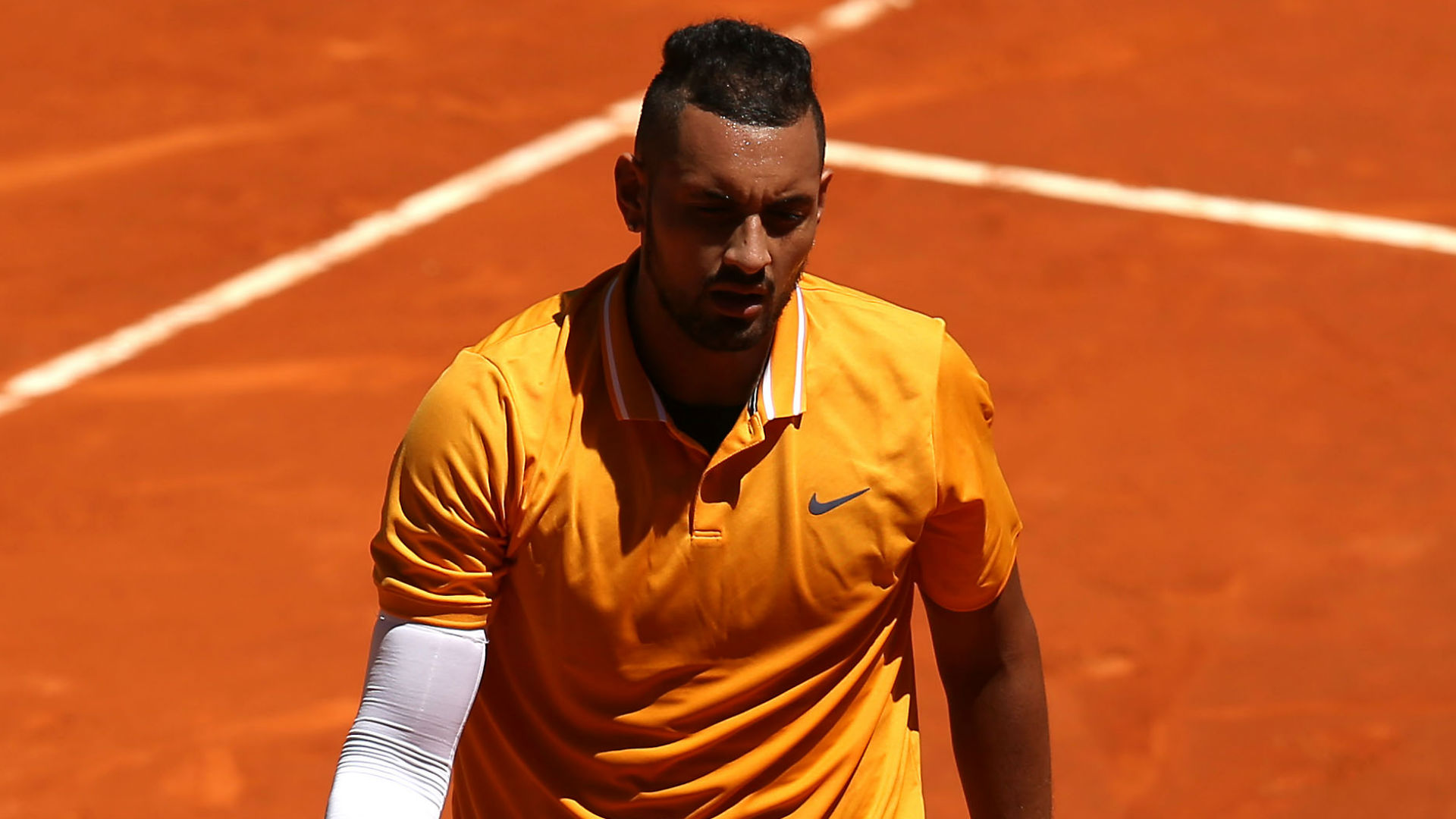 After becoming frustrated with the umpire, Nick Kyrgios responded to a game penalty by throwing a table before walking off court.
