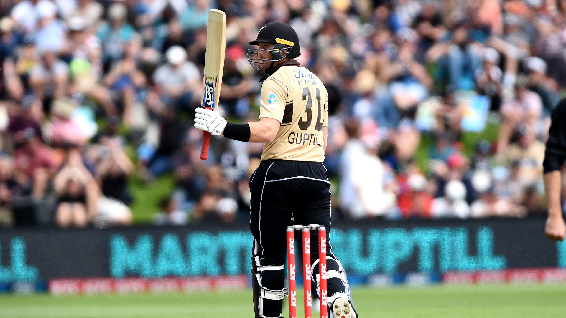 Martin Guptill led New Zealand to equal their six-hitting record in a tense four-run win against Australia in the second T20.
