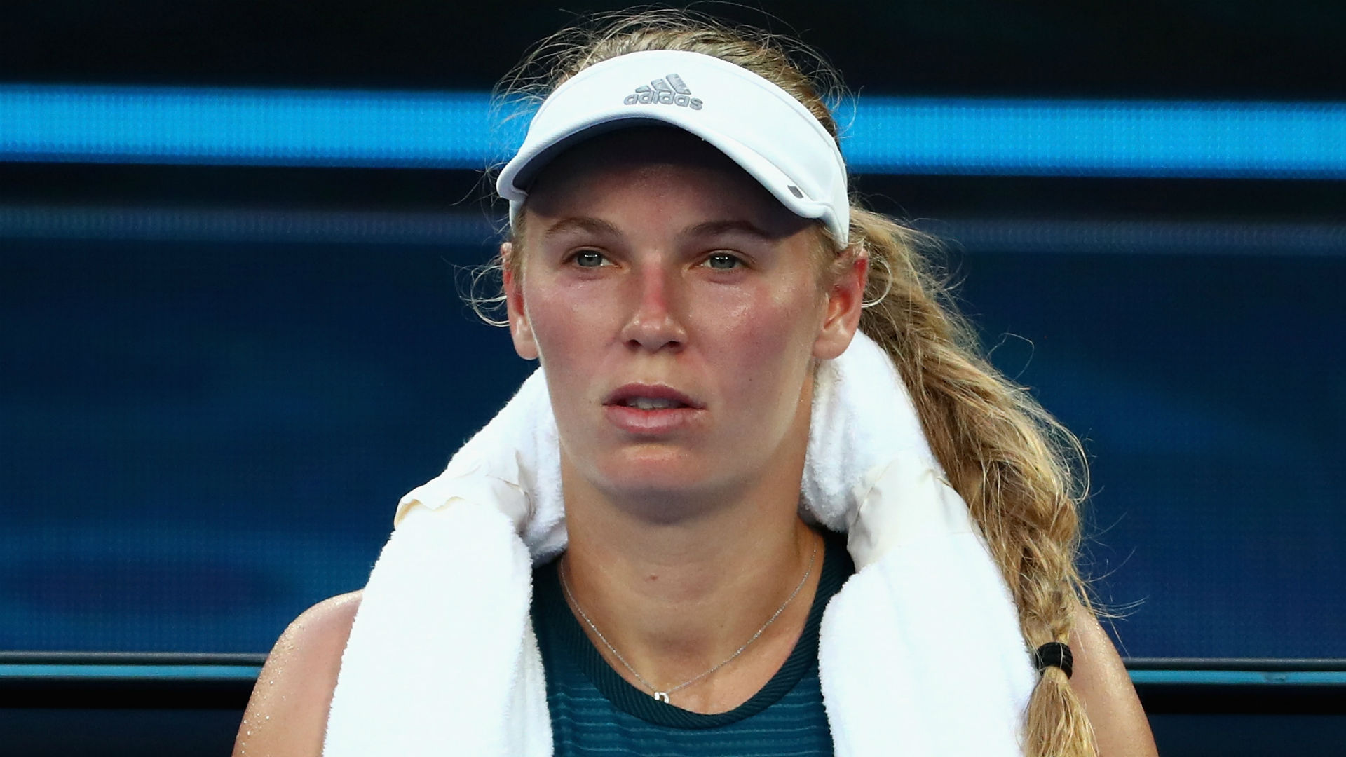 Caroline Wozniacki pulled out of the Qatar Open due to illness on a day in which she was due to face Karolina Muchova in the first round.