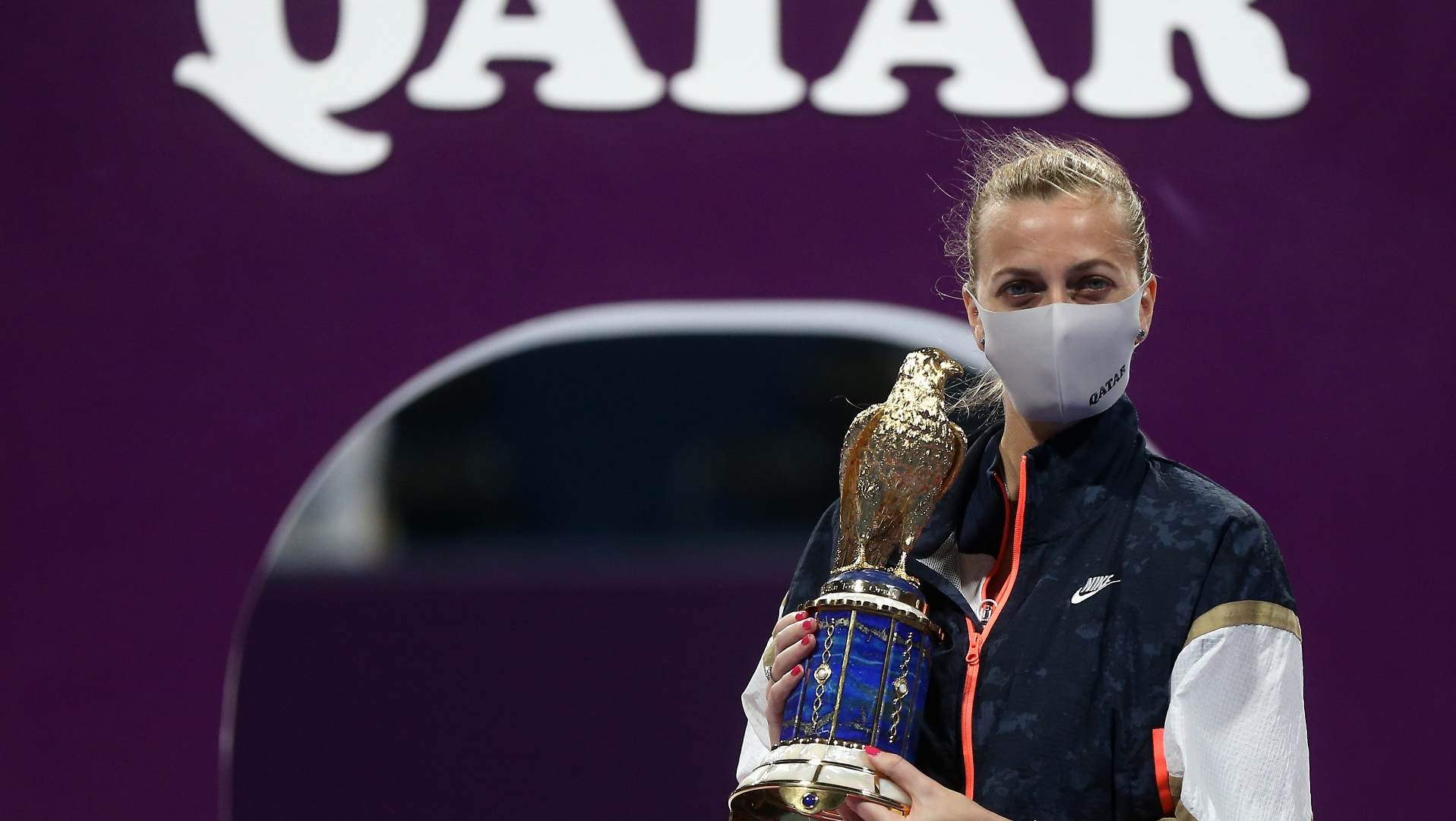 Petra Kvitova claimed her second Qatar Open title in her third final in four years with a 6-2 6-1 win over Garbine Muguruza.