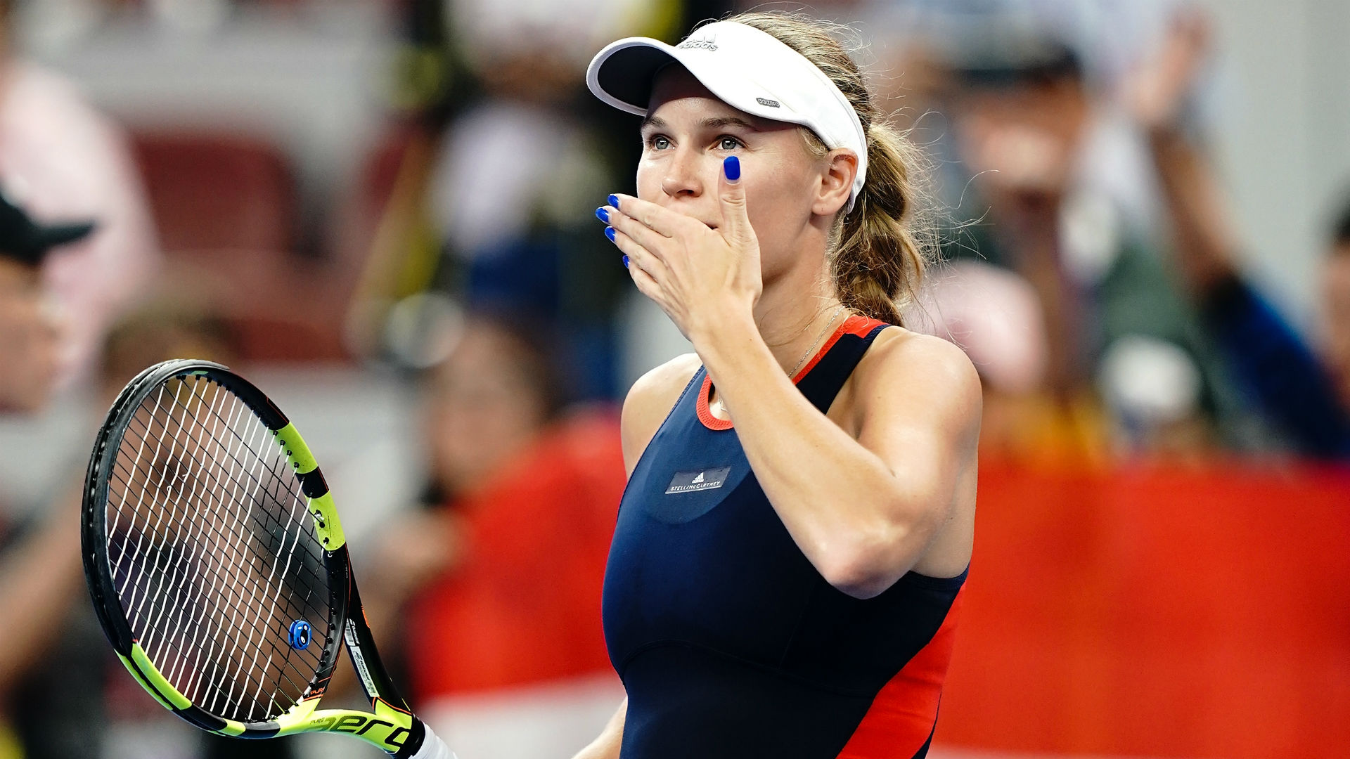 There will be no home champion at the China Open after Caroline Wozniacki overcame Wang Qiang in straight sets on Saturday.