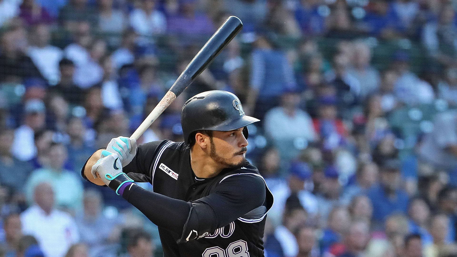 Nolan Arenado left Wednesday's game after being hit by a pitch from Cole Hamels.