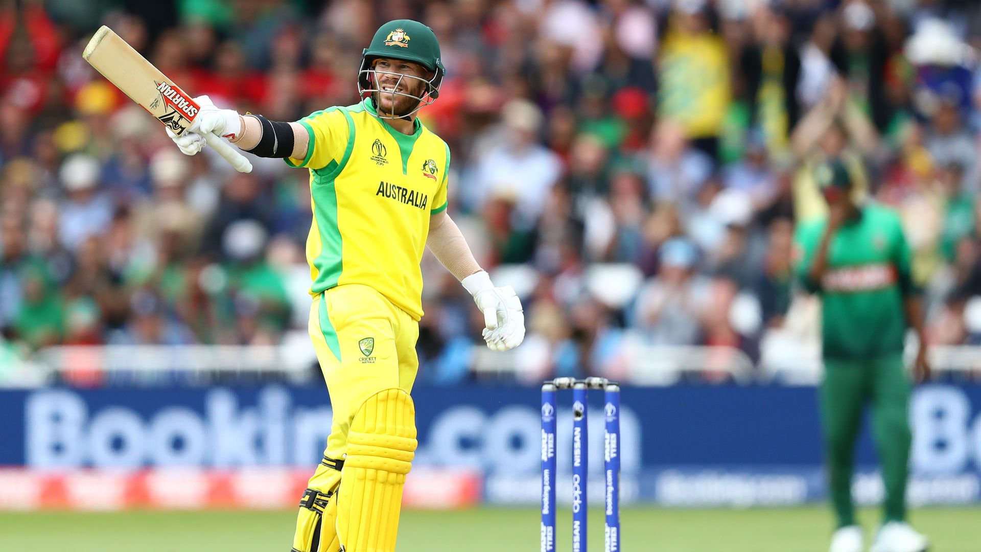 Australia moved to the top of the Cricket World Cup table by beating Bangladesh after David Warner made a magnificent 166.
