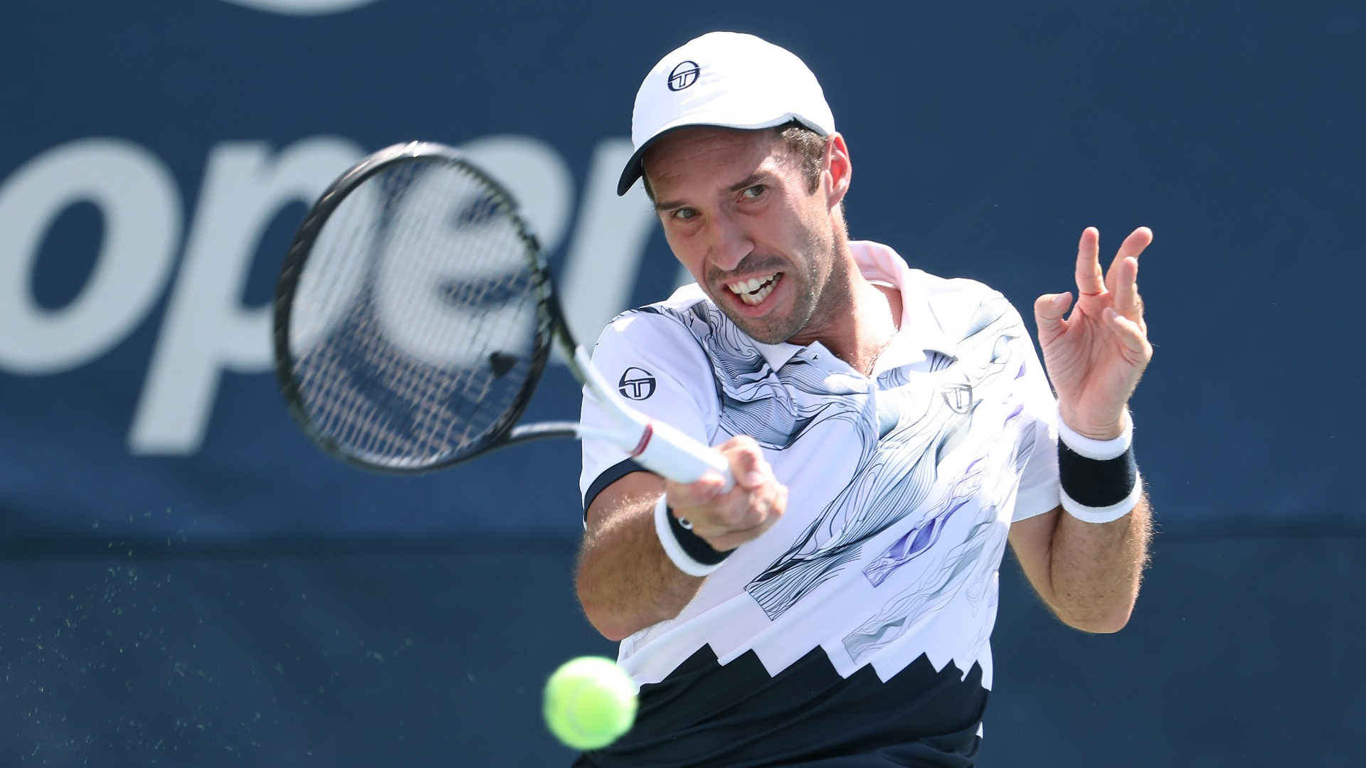 There were contrasting fortunes for two former title winners in Monday's ATP Tour events, with Mikhail Kukushkin advancing in Russia.