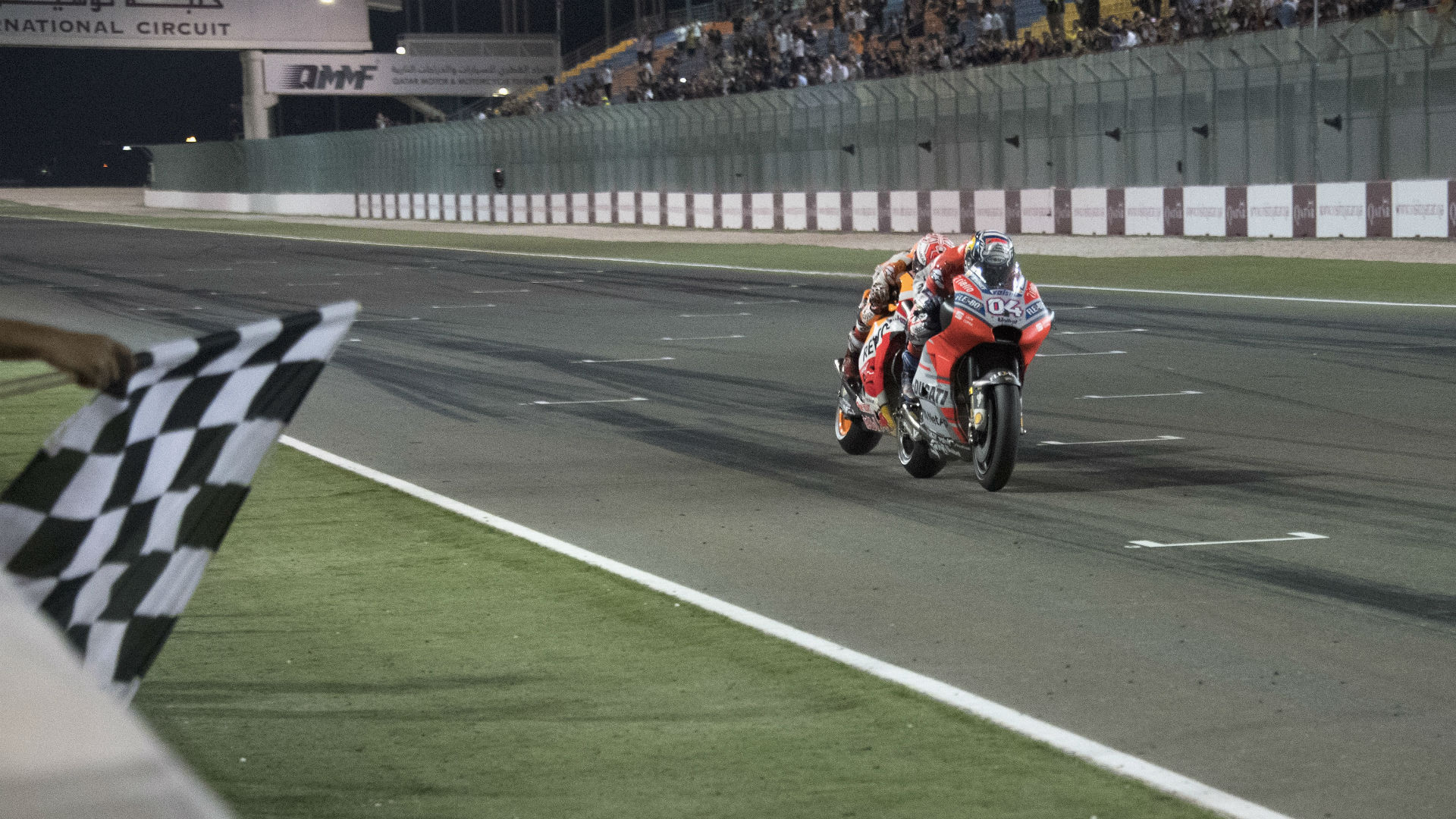 Andrea Dovizioso started the MotoGP season with a win, but Marc Marquez was content with second in Qatar.