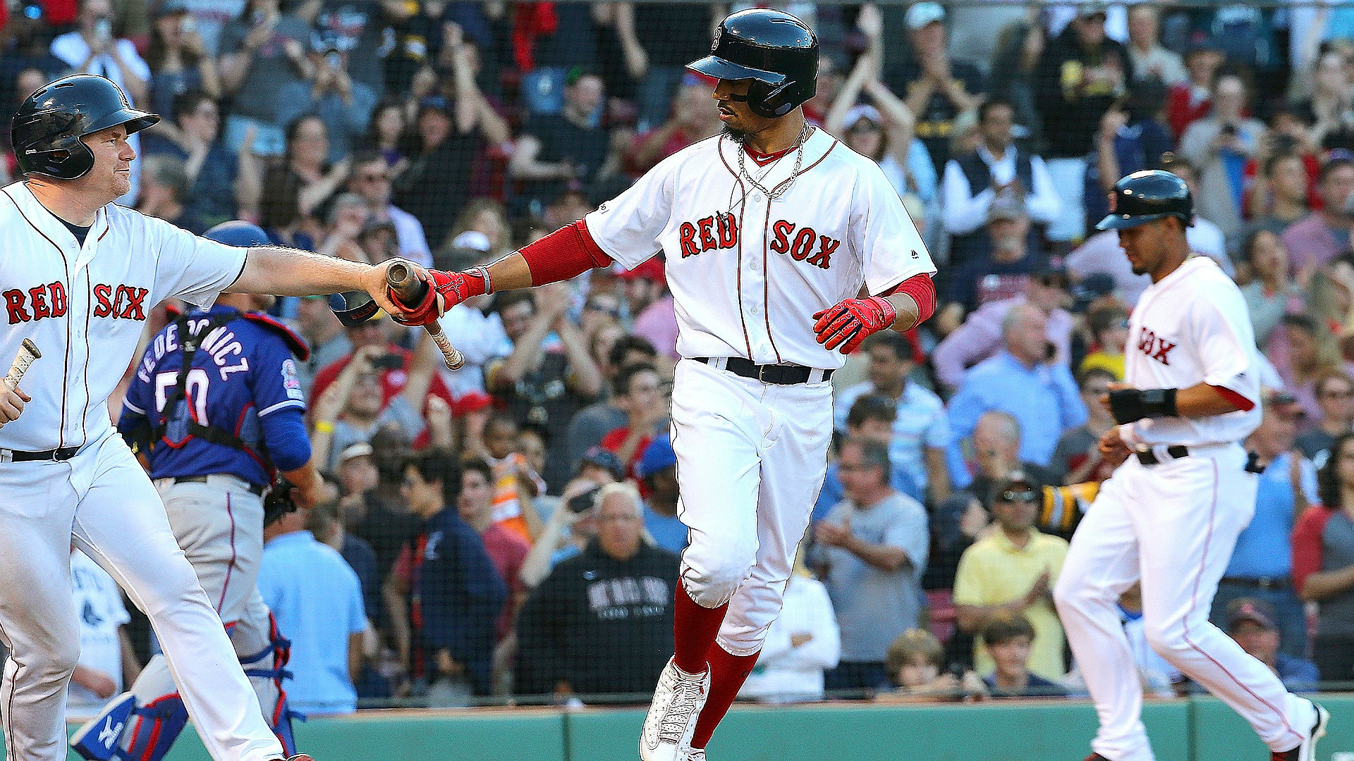 Jesse Chavez walked in Mookie Betts with the bases loaded in the bottom of the ninth to give the Red Sox a 4-3 win over the Rangers.