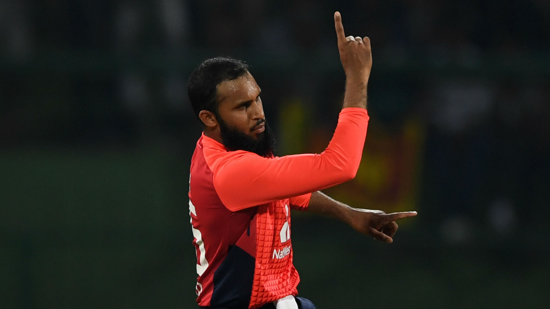 In a contest reduced to 21 overs-a-side, Adil Rashid took 4-36 and Eoin Morgan made 58 not out as England beat Sri Lanka by seven wickets.