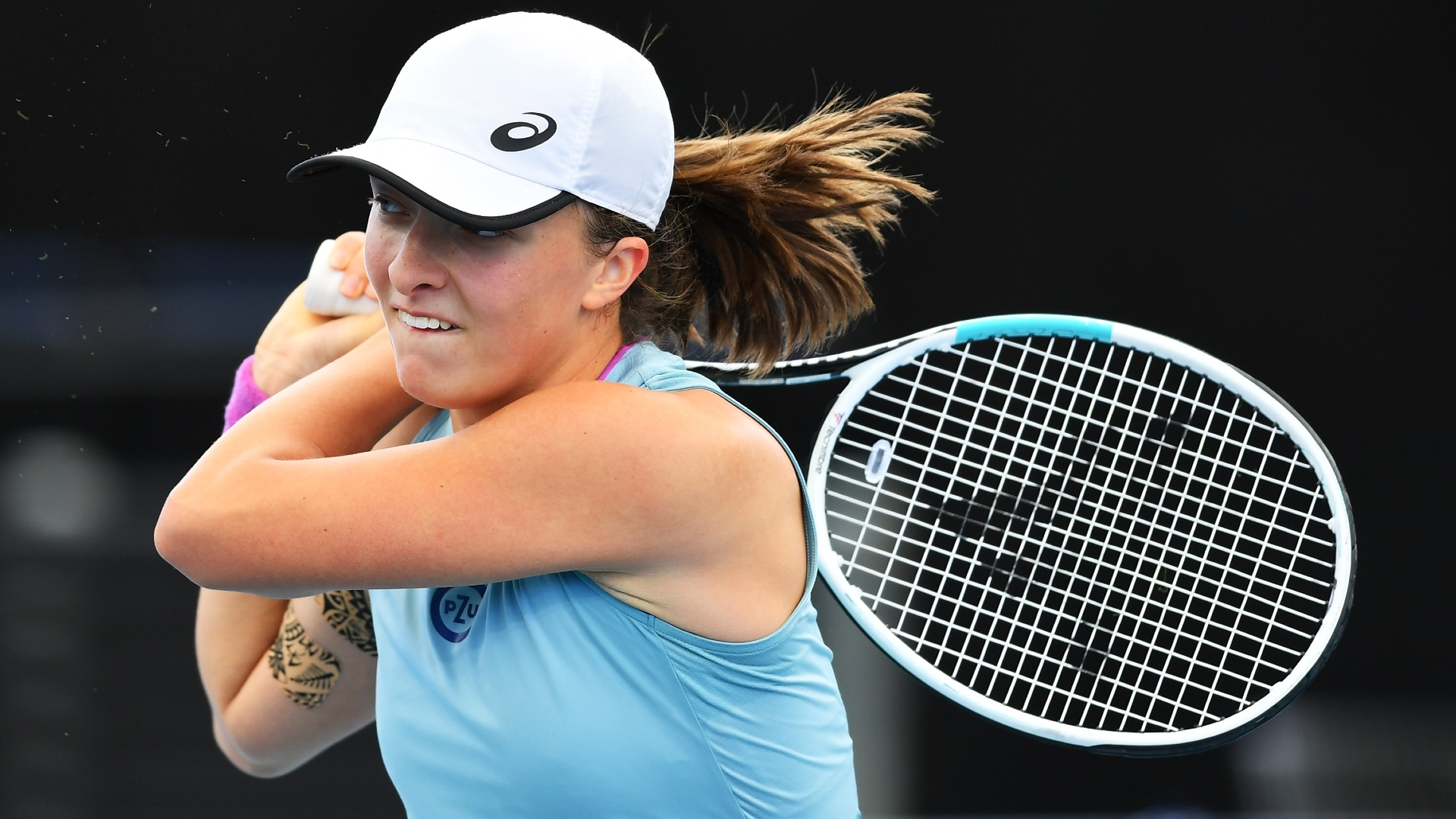 Johanna Konta was eliminated in Adelaide but there were no such problems for French Open champion Iga Swiatek.