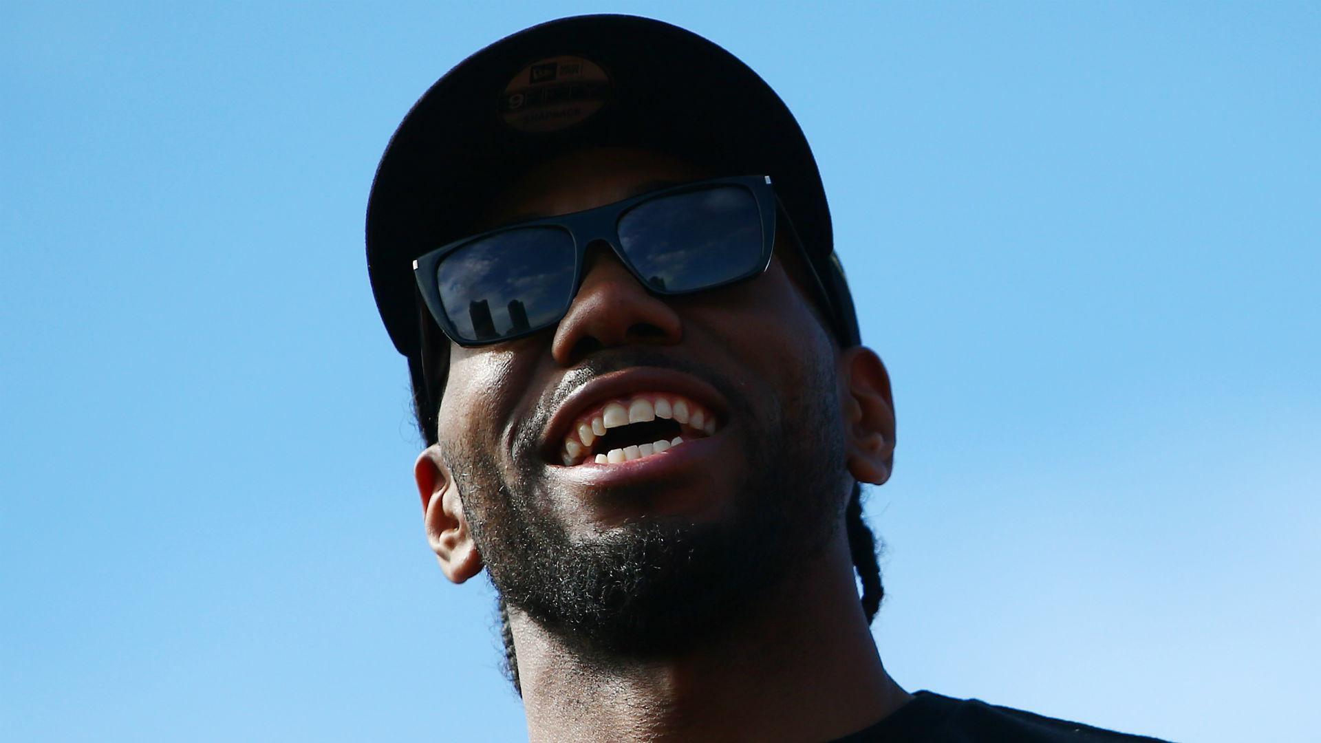 Toronto Raptors star Kawhi Leonard mimicked his laughter at the NBA champions' title parade on Monday.