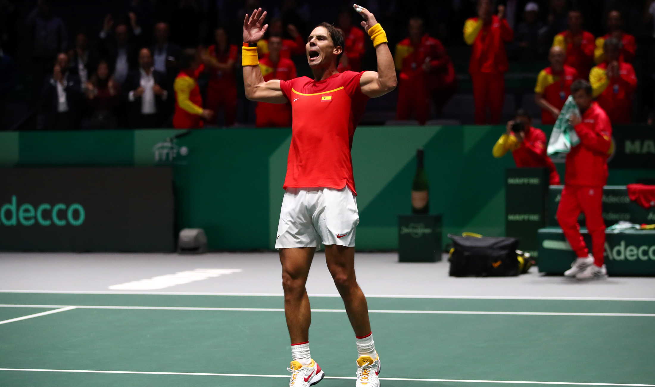 Spain overcame Russia in their Davis Cup Finals opener as Rafael Nadal claimed a singles win.