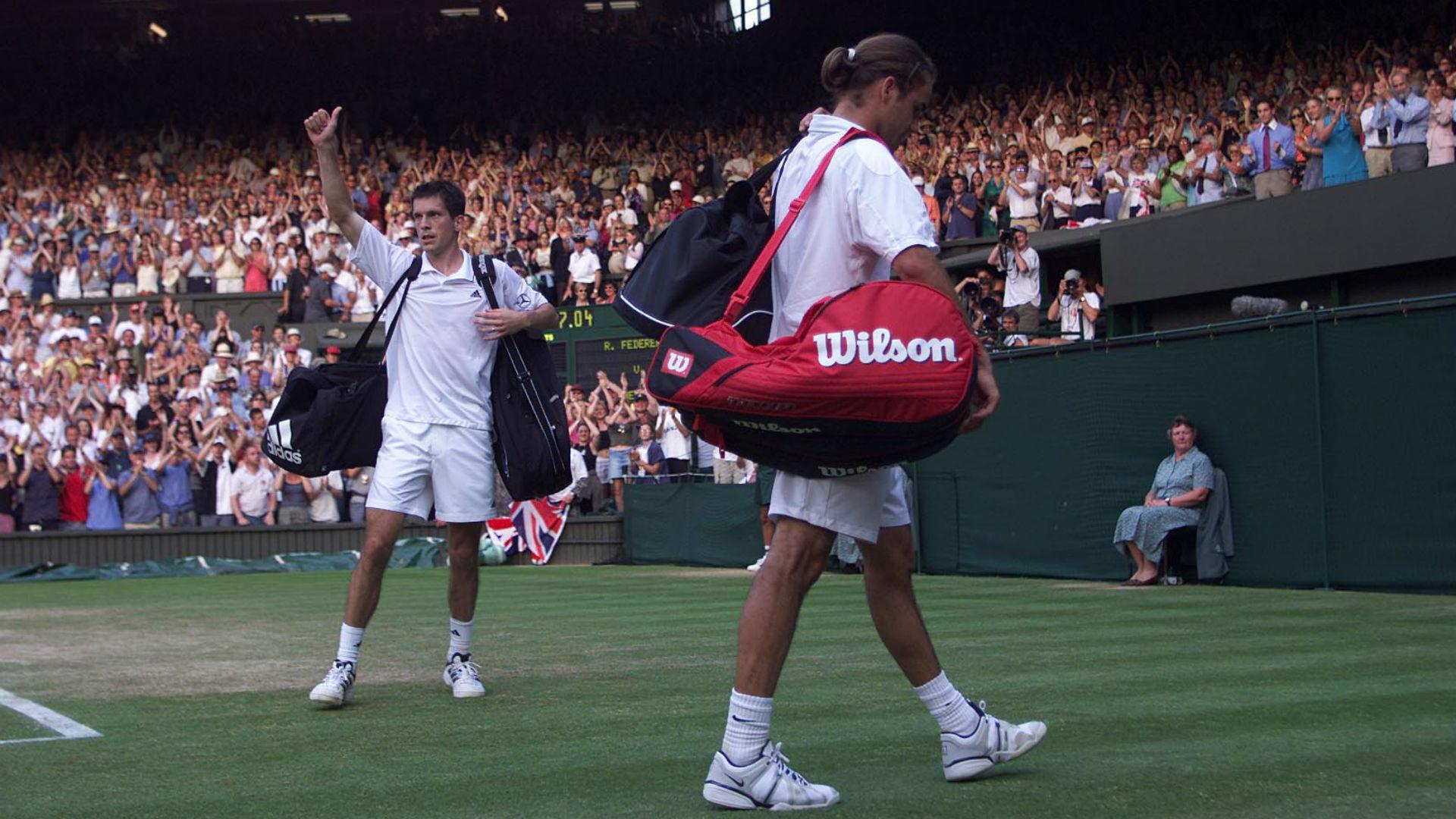 Henman savours beating Federer