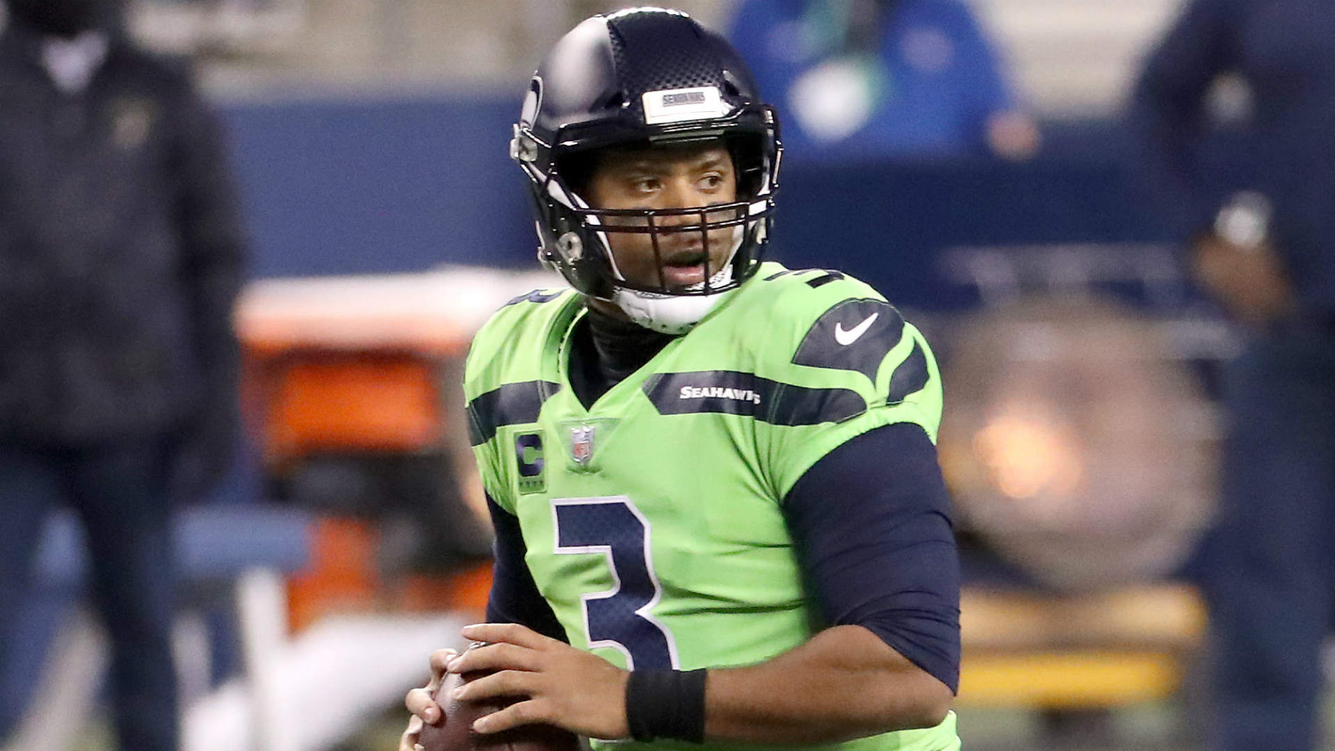 Carlos Dunlap said he sought assurances that Russell Wilson would still be in Seattle before re-signing with the Seahawks.