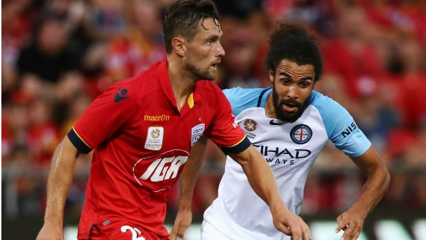 James Holland on the ball for the Reds at Coopers Stadium on Thursday night.