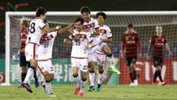 FC Seoul players celebrate their opening goal in the ACL clash against Western Sydney Wanderers in Campbelltown on Tuesday night.
