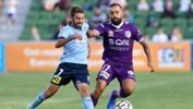 Perth Glory star Diego Castro fights off the attention on Sydney FC defender Michael Zullo.