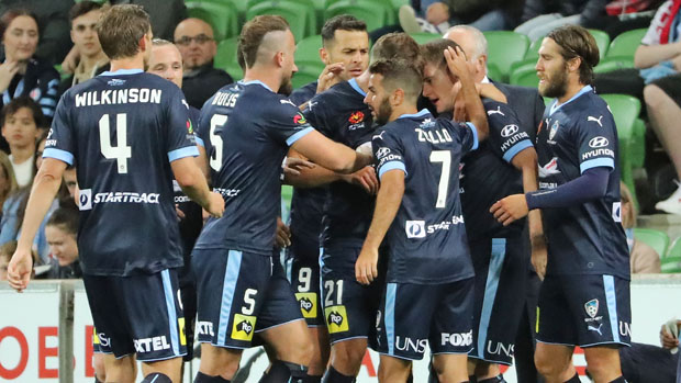 Sydney FC players celebrate a goal in their 3-1 win over Melbourne City.