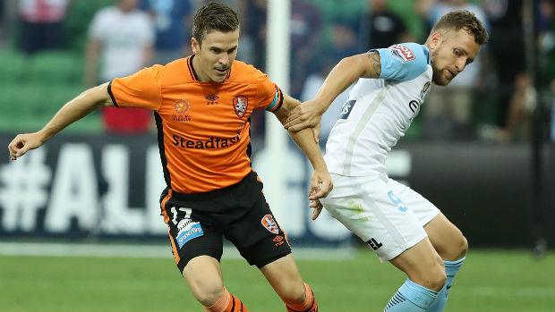 Roar captain Matt McKay and City's Nicolas Colazo jostle for possession at AAMI Park.