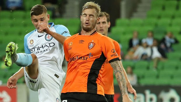 Dylan Pierias challenges for the ball with Roar's Jacob Pepper last weekend at AAMI Park.