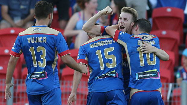Jets players celebrate Andrew Hoole's goal in the clash with Wellington on Boxing Day.