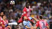 City defender Ruon Tongyik produces a great leap to head the danger clear against Sydney FC.