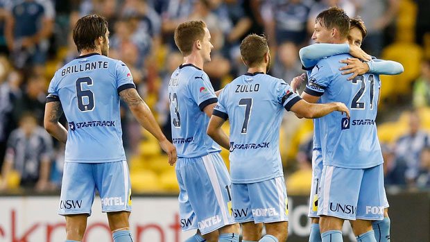 Sydney FC players congratulate Filip Holosko for his goal against Melbourne Victory in the Big Blue.