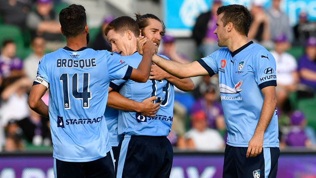 Sydney FC players celebrate a goal in their 3-0 win over Perth Glory.
