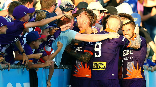 Perth Glory players celebrate Adam Taggart's winner against Victory on Saturday night.