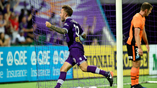 Glory striker Adam Taggart celebrates scoring his side's second equaliser against Brisbane on Saturday night.