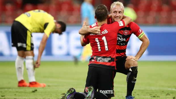 Wanderers striker Brendon Santalab celebrates one of his two goals against Wellington on Sunday.