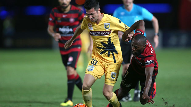 Luis Garcia challenges for the ball with Wanderers winger Romeo Castelen.