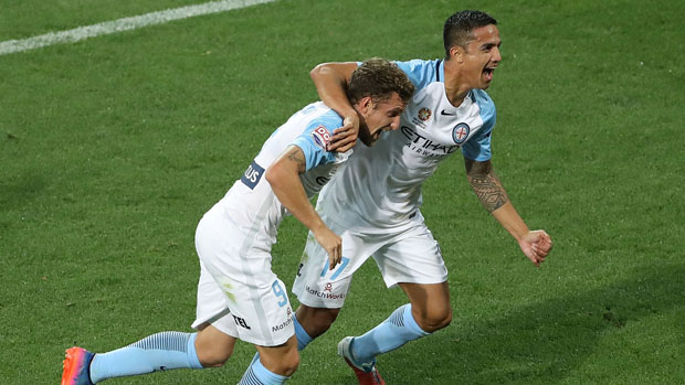 Tim Cahill celebrates with Nicolas Colazo after scoring in Melbourne City's win over Adelaide United.