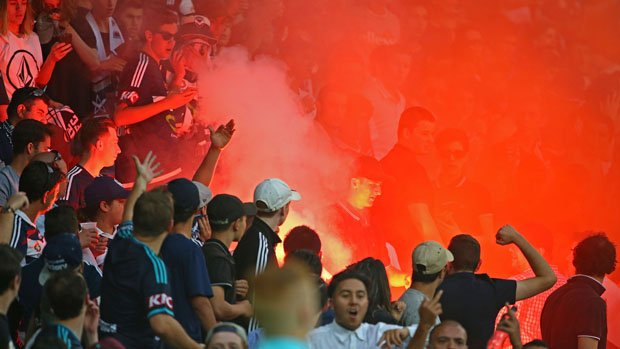 A flare is let off in the crowd during Saturday night's Melbourne Derby at AAMI Park.