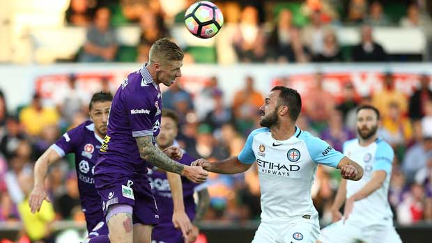 Andy Keogh rises highest to win a header over the Melbourne City defence.