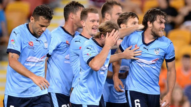 Josh Brillante celebrates scoring his first professional goal with Sydney FC teammates.