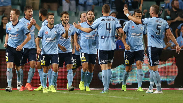 Sydney FC celebrate Filip Holosko's winner against the Mariners on Friday night.