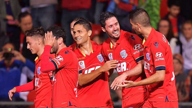 Adelaide United players celebrate Dylan McGowan's goal against the Wanderers on Saturday night.