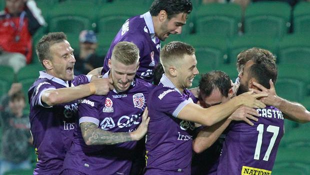Perth Glory celebrate a goal in their 3-1 win over Brisbane Roar.