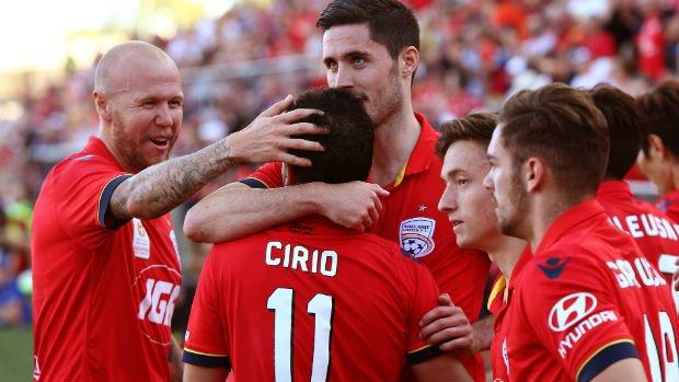 Adelaide United players celebrate Sergio Cirio's penalty against Brisbane on Sunday.
