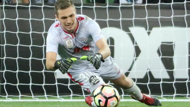Adelaide United goalkeeper Daniel Margush makes a save.