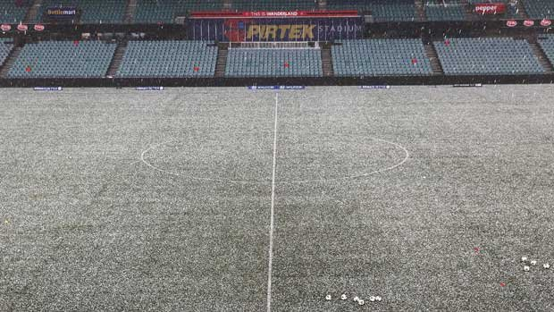 Pirtek Stadium covered in hailstones.