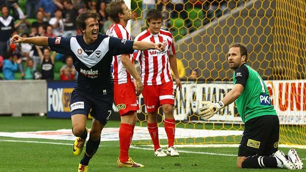 Robbie Kruse celebrates one of his two first-half goals for Victory in the Melbourne Derby.