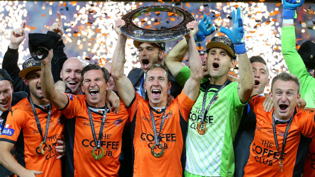 Brisbane Roar players celebrate their 2014 Hyundai A-League Championship.