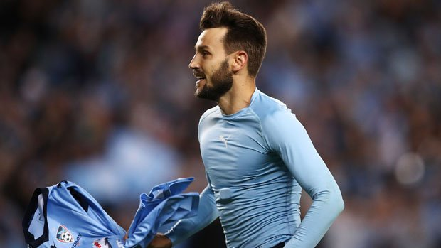 Milos Ninkovic celebrates after scoring the decisive penalty in Sydney FC's Grand Final triumph.