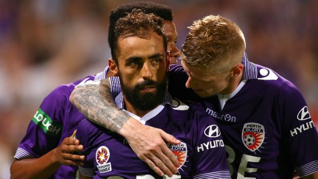 Glory striker Andy Keogh congratulates Diego Castro after he converts a penalty against Victory.
